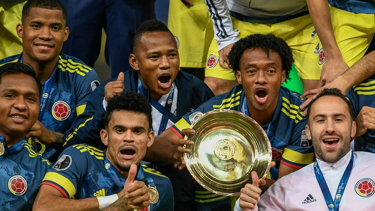 Colombia celebrate with the third-place trophy at the Copa America