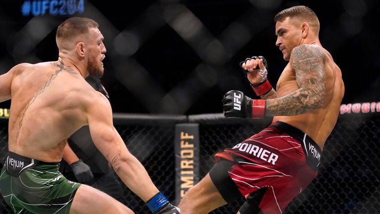 Dustin Poirier kicks Conor McGregor during the UFC 264 lightweight bout in Las Vegas