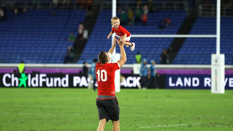 Biggar with his son during the 2019 World Cup in Japan