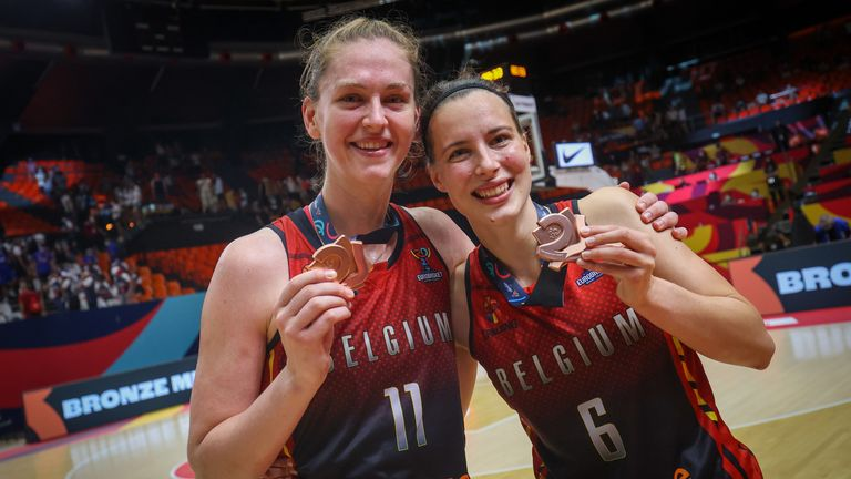 Belgian Cats' stars Emma Meesseman and Antonia Tonia Delaere celebrate with their bronze medals after defeating Belarus in the Third Place Game during the FIBA Women's European Basketball championships in 2021