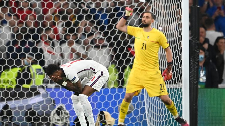 England's Marcus Rashford reacts after missed a penalty shot during the penalty shootout during the Euro 2020 soccer final match between England and Italy at Wembley