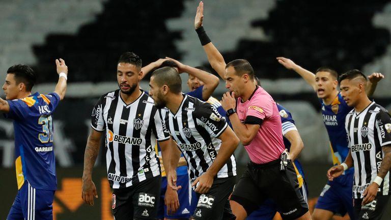 Referee Esteban Ostojich disallows a goal scored by Boca Juniors' Marcelo Weigandt