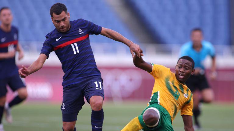 France midfielder Teji Savanier (L) scored his side's winning goal