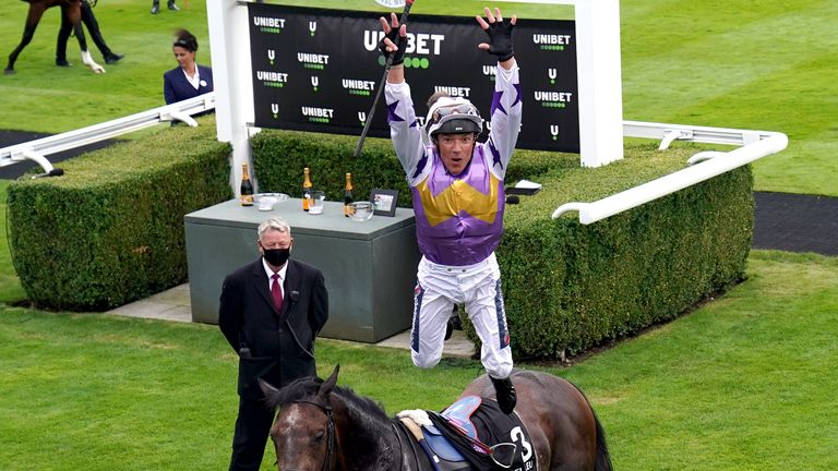 Frankie Dettori treats the Goodwood crowd to a flying dismount after victory on Angel Bleu