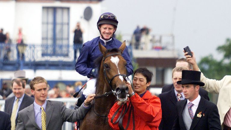 Galileo is greeted in the winner's enclosure after winning at Epsom in 2001