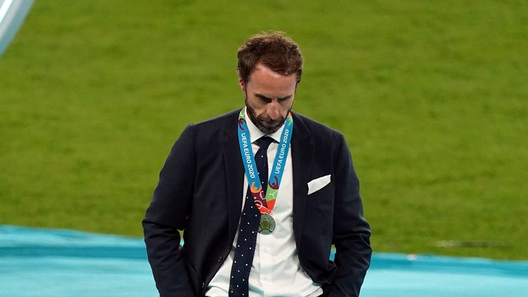 England coach Gareth Southgate and Harry Kane (left) are disheartened after the UEFA Euro 2020 final at Wembley Stadium