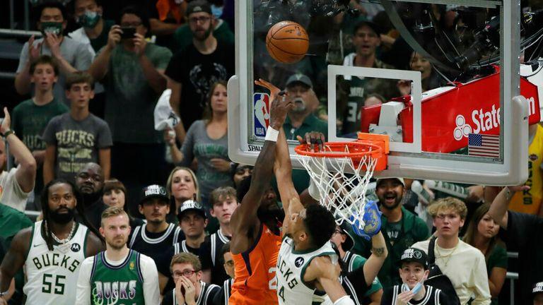 Milwaukee Bucks' Giannis Antetokounmpo (34) blocks Phoenix Suns' Deandre Ayton during the second half of Game 4 of basketball's NBA Finals Wednesday, July 14, 2021, in Milwaukee. (AP Photo/Aaron Gash)