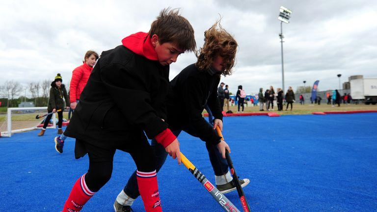 General view of schoolchildren playing hockey
