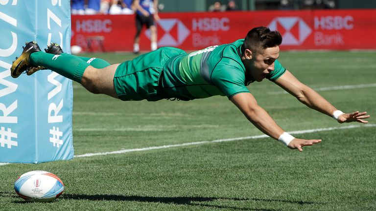 Ireland's Greg O'Shea dives forward after scoring against Australia during the Rugby Sevens World Cup in San Francisco, Sunday, July 22, 2018.