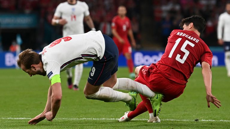 Harry Kane is challenged by Denmark's Christian Norgaard