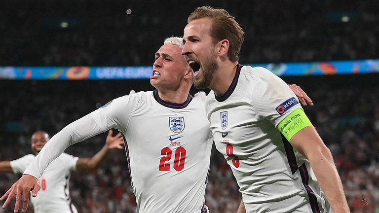 England's Harry Kane celebrates with Phil Foden after scoring in extra-time