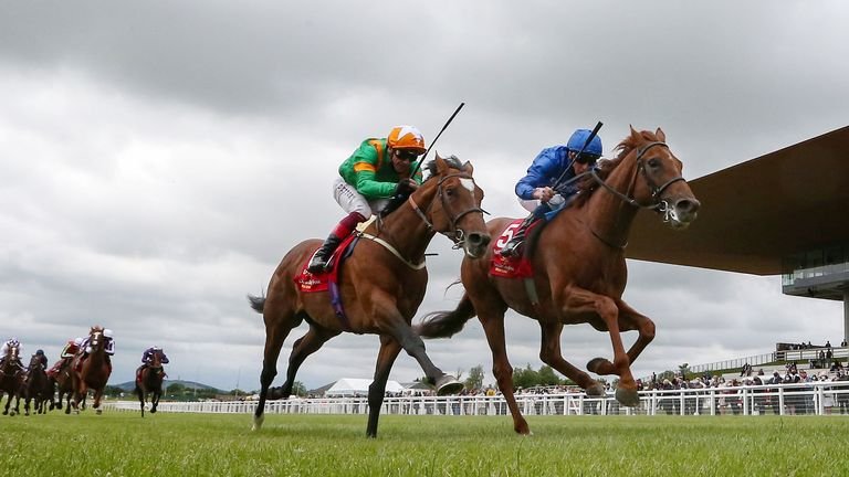 Hurricane Lane battles past Lone Eagle at the Curragh, with the front two well clear of the rest of the field