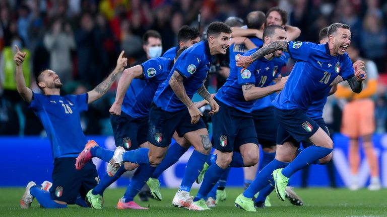 Italy players celebrate after Jorginho scored the decisive shootout penalty, during the Euro 2020 soccer semifinal match between Italy and Spain at Wembley