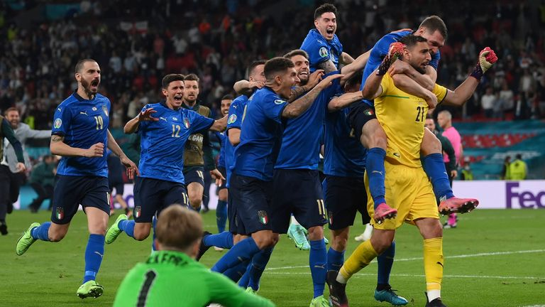 Italian players celebrate after the penalty shootout of the Euro 2020 soccer final match between England and Italy at Wembley