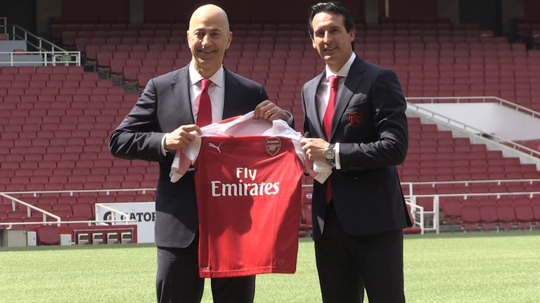 New Arsenal manager Unai Emery (right) with chief executive Ivan Gazidis on the pitch after a press conference at the Emirates Stadium, London (2018)