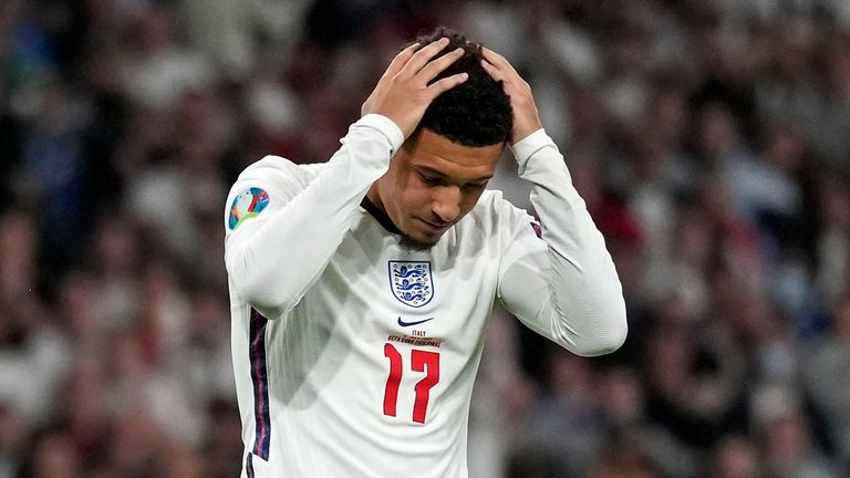 England's Jadon Sancho reacts after he missed to score during the penalty shootout of the Euro 2020 soccer championship final between England and Italy at Wembley