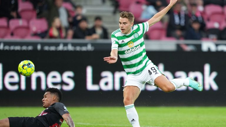 Celtic's James Forrest has a shot blocked by Paulinho