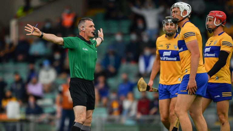 Cathal Malone, Conor Cleary and John Conlon of Clare look on as referee James Owens awards a penalty