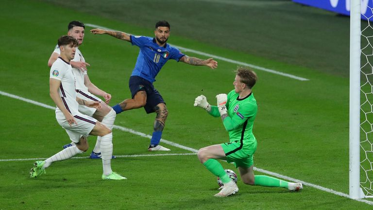 Jordan Pickford of England makes a save from Lorenzo Insigne of Italy during the UEFA Euro 2020 final at Wembley