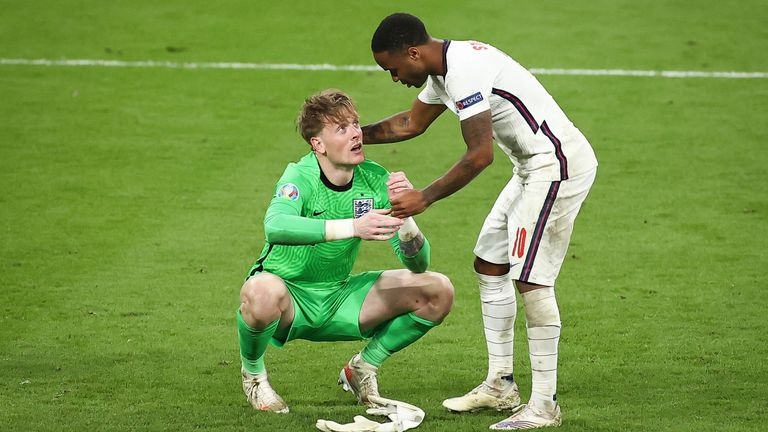 Raheem Sterling consoles Pickford during the final