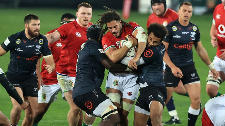 Josh Navidi of the British and Irish Lions is tackled by James Venter and Jaden Hendrikse