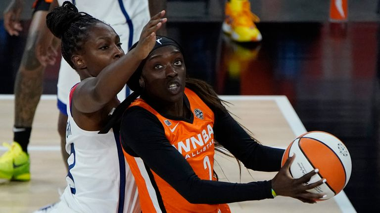 Team WNBA's Kahleah Copper shoots around United States' Chelsea Gray during the WNBA All-Star basketball game