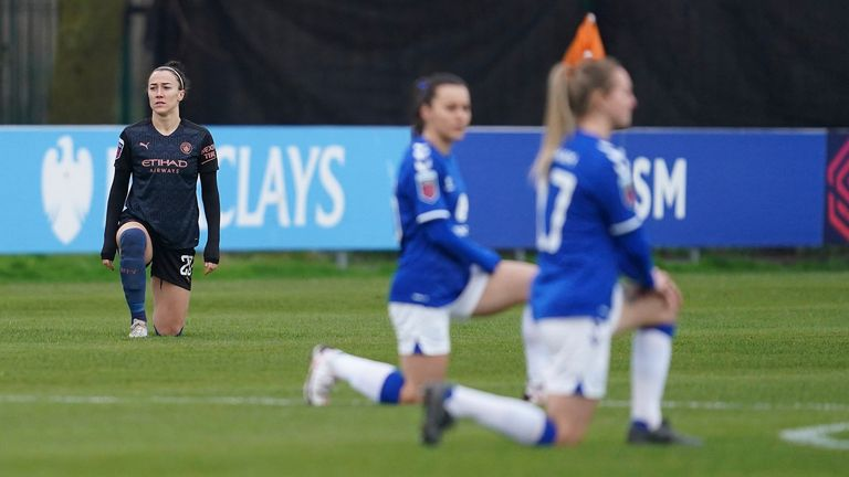 Players kneel before the FA WSL football match between the Everton Women's Team and the Manchester City Women's Team at Walton Hall Park Stadium in Liverpool, England, on Sunday, December 6, 2020.