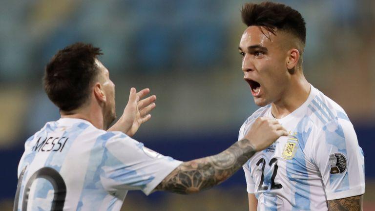 Lautaro Martinez and Lionel Messi celebrate after scoring