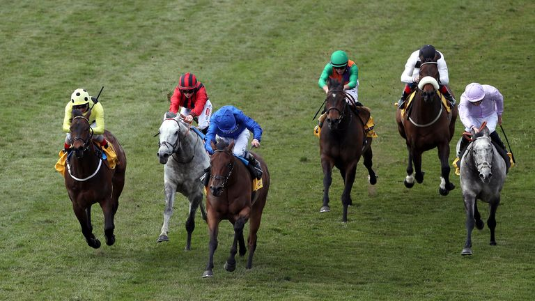 Lazuli (blue) wins the Palace House Stakes at Newmarket in May