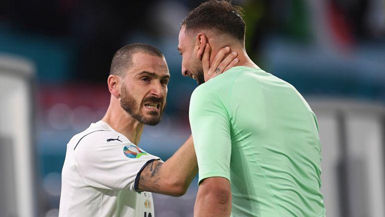 Leonardo Bonucci celebrates with Gianluigi Donnarumma