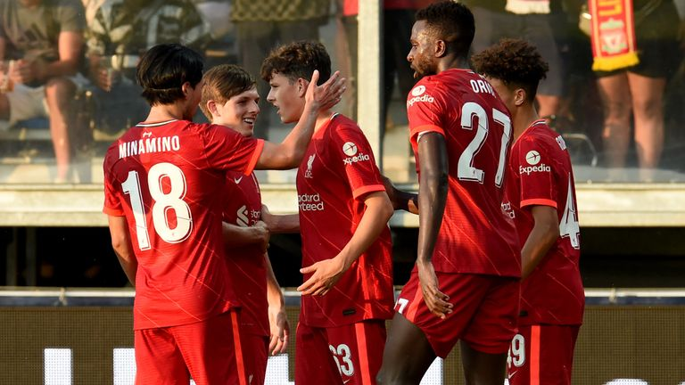 Liverpool players celebrate after the late own goal winner