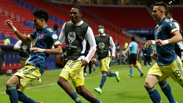 Luis Diaz (far left) celebrates after his stunning injury time winner