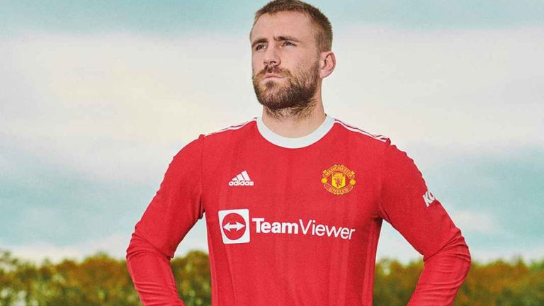 Luke Shaw in the new Manchester United home shirt (Credit: ManUtd.com)