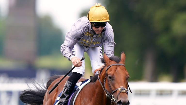 Pat Dobbs rides Lusail to victory in the July Stakes at Newmarket