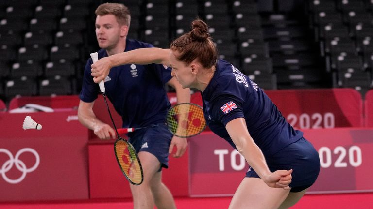Britain's Marcus Ellis and Lauren Smith play against France's Thom Giquel and Delphone Delrue