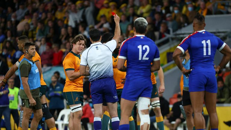 The referee gives a red to Australia's Marika Koroibete while Michael Hooper looks on