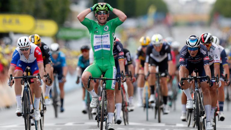 Britain's Mark Cavendish, wearing the best sprinter's green, celebrates as he crosses the finish line to win the sixth stage of the Tour de France cycling race over 160.6 kilometers (99.8 miles) with start in Tours and finish in Chateauroux, France, Thursday, July 1, 2021. (Guillaume Horcajuelo, Pool Photo via AP)