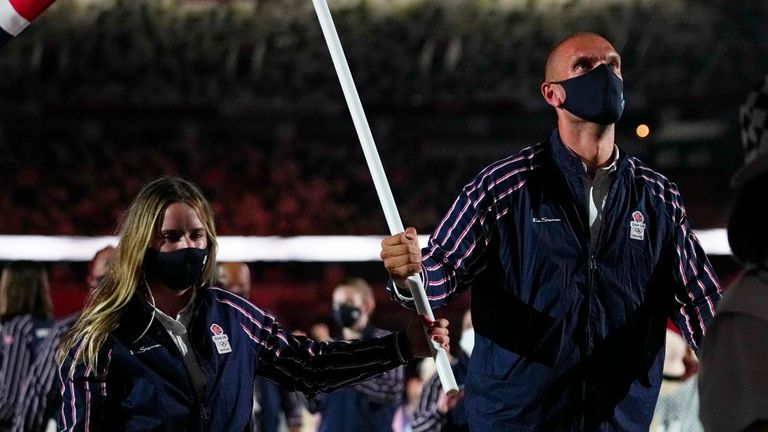 Hannah Mills and Mohamed Sbihi, of Britain, carry their country's flag during the opening ceremony in the Olympic Stadium at the 2020 Summer Olympics, Friday, July 23, 2021, in Tokyo, Japan. (AP Photo/Petr David Josek)