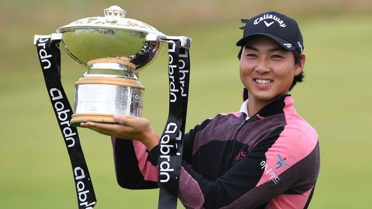 Min Woo Lee with the trophy after winning the abrdn Scottish Open