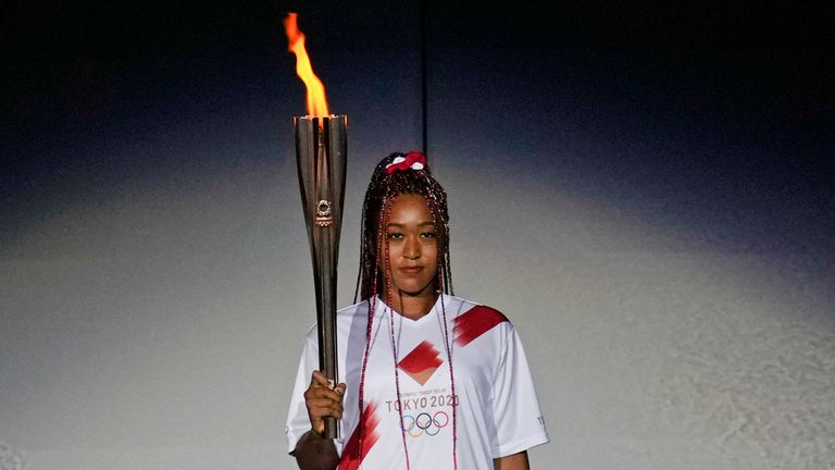 Naomi Osaka ignites the torch during the Opening Ceremony of the Tokyo 2020 Olympic Games at the National Stadium