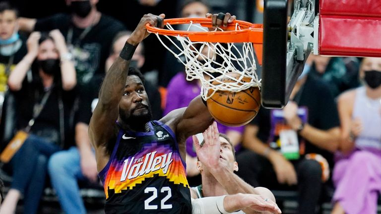Phoenix Suns center Deandre Ayton (22) dunks against Milwaukee Bucks center Brook Lopez (11) during the second half of Game 1 of basketball's NBA Finals, Tuesday, July 6, 2021, in Phoenix.