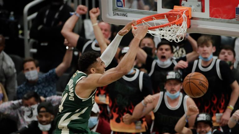 Milwaukee Bucks' Giannis Antetokounmpo (34) dunks during the first half of Game 3 of basketball's NBA Finals against the Phoenix Suns, Sunday, July 11, 2021, in Milwaukee.