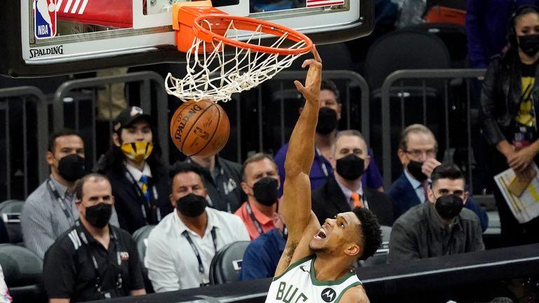 Milwaukee Bucks forward Giannis Antetokounmpo (34) dunks against the Phoenix Suns during the first half of Game 2 of basketball's NBA Finals, Thursday, July 8, 2021, in Phoenix. (AP Photo/Matt York)