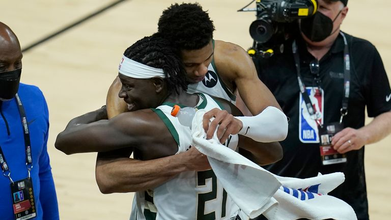 Milwaukee Bucks forward Giannis Antetokounmpo, top, celebrates with guard Jrue Holiday (21) after the Bucks defeated the Phoenix Suns in Game 5 of basketball's NBA Finals, Saturday, July 17, 2021, in Phoenix.