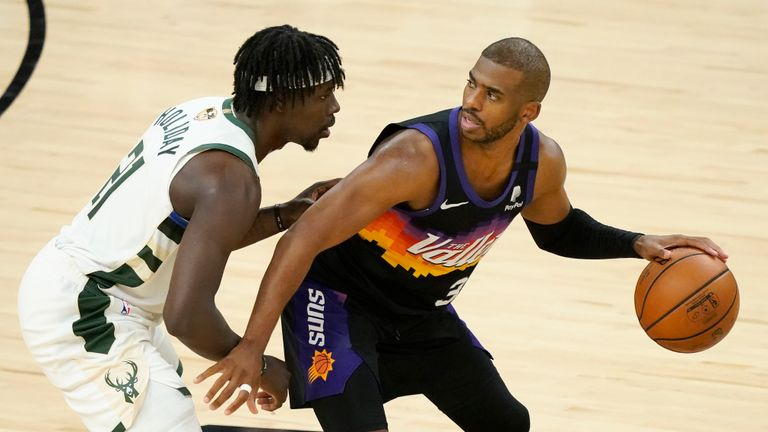 Phoenix Suns guard Chris Paul, right, is defended by Milwaukee Bucks guard Jrue Holiday during the second half of Game 2 of basketball's NBA Finals, Thursday, July 8, 2021, in Phoenix. (AP Photo/Matt York)