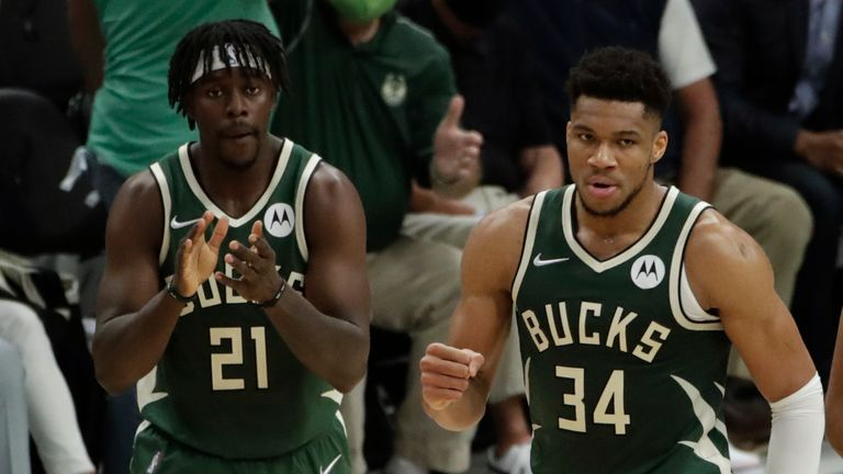Milwaukee Bucks' Giannis Antetokounmpo (34) reacts during the first half of Game 3 of basketball's NBA Finals against the Phoenix Suns Sunday, July 11, 2021, in Milwaukee.