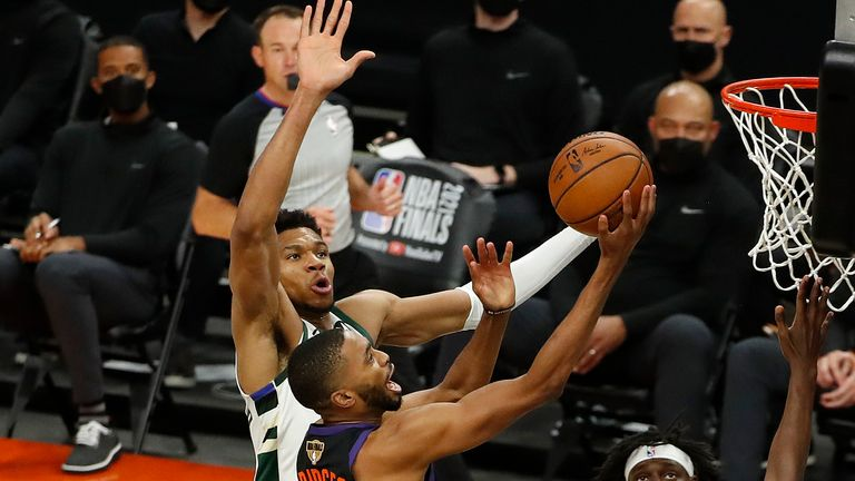 Mikal Bridges #25 of the Phoenix Suns goes up for a shot against Giannis Antetokounmpo #34 of the Milwaukee Bucks during the first half in Game One of the NBA Finals at Phoenix Suns Arena on July 06, 2021 in Phoenix, Arizona.