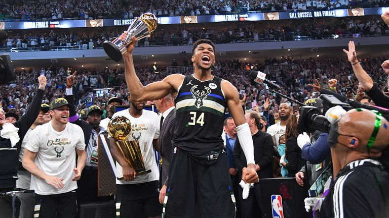 MILWAUKEE, WI - JULY 20: Giannis Antetokounmpo #34 of the Milwaukee Bucks celebrates after receiving the Bill Russell Finals MVP Award after winning Game Six of the 2021 NBA Finals against the Phoenix Suns on July 20, 2021 at Fiserv Forum in Milwaukee, Wisconsin. NOTE TO USER: User expressly acknowledges and agrees that, by downloading and/or using this Photograph, user is consenting to the terms and conditions of the Getty Images License Agreement. Mandatory Copyright Notice: Copyright 2021 NBAE (Photo by Jesse D. Garrabrant/NBAE via Getty Images)