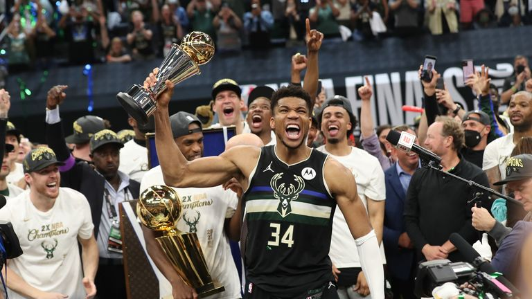 MILWAUKEE, WI - July 17: Giannis Antetokounmpo #34 of the Milwaukee Bucks celebrates winning the Bill Russell NBA Finals MVP Award after defeating the Phoenix Suns in Game Six to win the 2021 NBA Finals on July 17, 2021 at Fiserv Forum in Milwaukee, Wisconsin. NOTE TO USER: User expressly acknowledges and agrees that, by downloading and or using this photograph, user is consenting to the terms and conditions of the Getty Images License Agreement. Mandatory Copyright Notice: Copyright 2021 NBAE (Photo by Joe Murphy/NBAE via Getty Images)