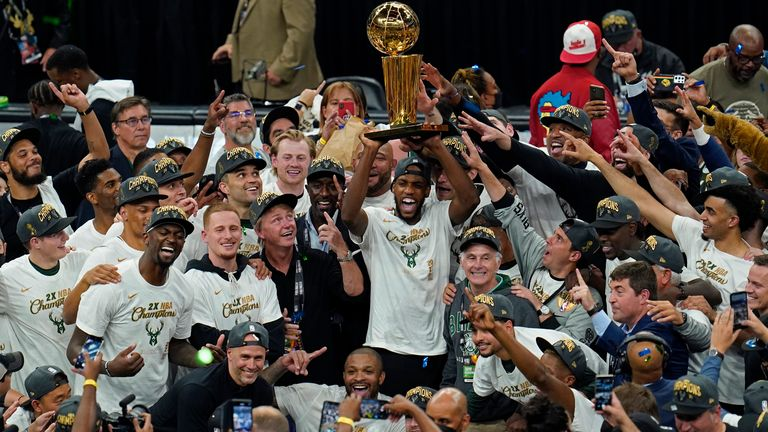 Khris Middleton lifts the Larry O'Brien trophy as the Milwaukee Bucks celebrate the 2021 NBA Championship